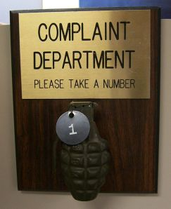 Complaint Department grenade by Adam the atom , distributed under a CC BY-SA 3.0 license.