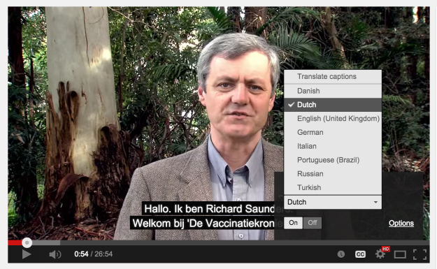 Richard Saunders in The Vaccination Chronicles, showing the YouTube caption language menu.